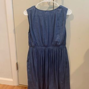 Silk Vera Wang dress worn once with side pockets.